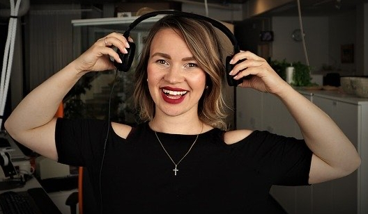 Happy Female podcast host